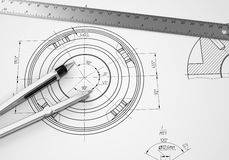 Compass and ruler lie on the drawing Royalty Free Stock Image