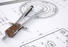 Compass and ruler lie on the drawing Royalty Free Stock Photos
