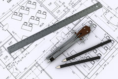 Compass, ruler and pencil on architectural drawing Royalty Free Stock Photo