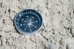 Compass in the sand Royalty Free Stock Photo