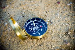 Compass on sand Stock Photo
