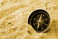 Compass and sand Royalty Free Stock Photos