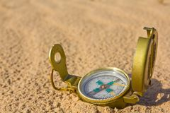 Compass on a sand Royalty Free Stock Image