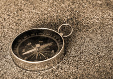 Compass on the sand Stock Photo