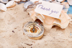 Compass in the sand with Message - Thank you Stock Photos