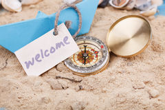 Compass in the sand with Message - Welcome Stock Photography