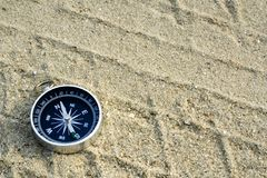 Compass on sand track stock photography