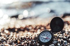 Compass on a sandy beach. Against the sea, soft focus, concept of rest, travel, tourism, navigation, orientation stock photo