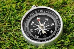 Compass. A compass sat on green grass Stock Photo