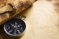 Compass and scroll on old paper Royalty Free Stock Images