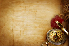 Compass and scroll with wax seal on vintage old paper royalty free stock photos