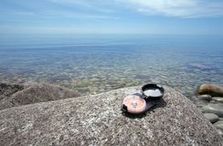 Compass & sea Royalty Free Stock Photos