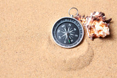Compass on the sea sand Royalty Free Stock Photography
