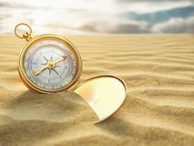 Compass on sea sand. Travel destination and navigation concept. Royalty Free Stock Image