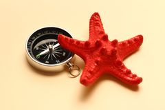 Compass and sea star Stock Image