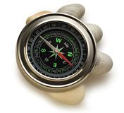 Compass and sea stones Royalty Free Stock Images