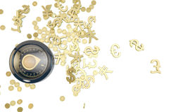 Compass in search of gold. A new compass in search of gold on white background, financial concept Stock Image