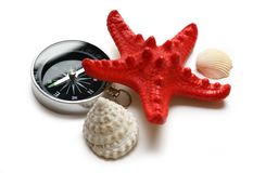 Compass, seastar and seashells Stock Photography