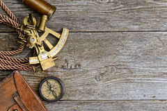 Compass,sextant and spyglass on the timber Royalty Free Stock Images