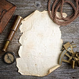 Compass,sextant and spyglass on the timber Stock Images