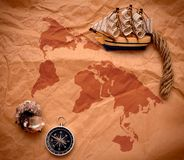 Compass, shell and model classic boat on old paper Stock Photo