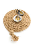 Compass and ship rope on white Royalty Free Stock Images