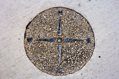Compass in Sidewalk Royalty Free Stock Photos