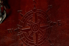 Compass sign on leather cover Royalty Free Stock Photo