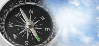 Compass in sky. Compass in a blue sky Royalty Free Stock Photos