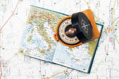 Compass and small atlas stock photo