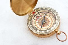 Compass in the snow Stock Photo