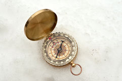 Compass in the snow Royalty Free Stock Images