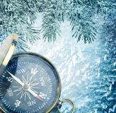 Compass on snow. Background with fir decoration stock photos