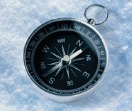 Compass on snow Royalty Free Stock Photos