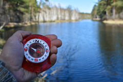 With compass on spring river. Royalty Free Stock Image