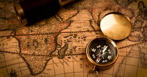 Compass and spyglass on ancient world map stock video footage