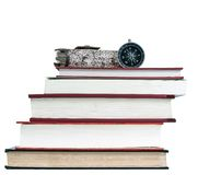 Compass on stack of books. With white background Royalty Free Stock Photos