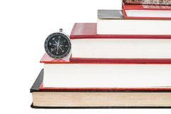 Compass on stack of books. With white background Royalty Free Stock Photography