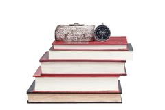 Compass on stack of books. With white background Stock Photo