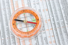 Compass on stock market numbers Stock Image