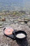 Compass & stone Stock Photos