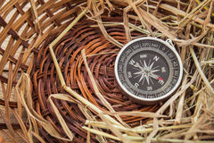 Compass and straw in basket Stock Images