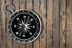 Compass on tablet. Path travel find compass achievement alternatives Royalty Free Stock Image