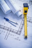 Compass tapeline blueprints Stock Image