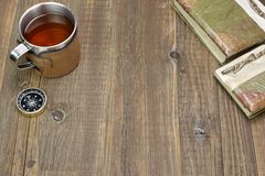 Compass, Tea Mug and Two Notebooks on Wood Table Royalty Free Stock Photos