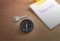 Compass with text success in business concept and key background Royalty Free Stock Photos