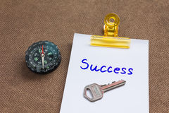 Compass with text success in business concept and key background Stock Photo