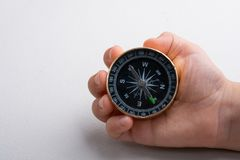 Compass tool in hand on white stock image