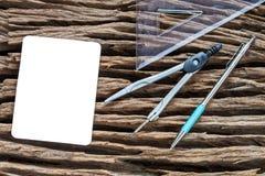 Compass tools set on wood Stock Photos