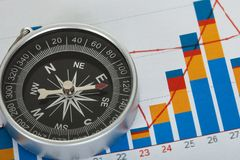 Compass on top of business data papers Royalty Free Stock Photos